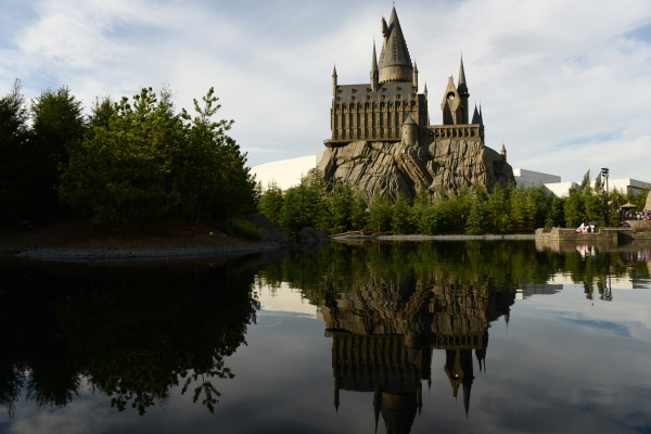 The Wizarding World of Harry Potter themed area stands at Universal Studios Japan, operated by USJ Co., in Osaka, Japan, on Thursday, Aug. 7, 2014. USJ is counting on its cachet turning around a failing Universal Studios theme park in Japan to win a partnership with a foreign casino operator. As the country edges nearer to legalizing gambling resorts, the company is in talks with MGM Resorts International, Caesars Entertainment Corp. and Genting Bhd. for a possible tie-up, Chief Executive Officer Glenn Gumpel said in an interview. Photographer: Noriko Hayashi/Bloomberg