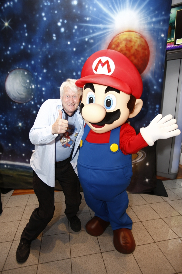 New York, N.Y. 05/21/10 - Charles Martinet, the voice of Mario, poses with the Mario character at an exclusive launch event celebrating the upcoming launch of the Super Mario Galaxy 2 game at the Nintendo World store in New York on May 21, 2010. Super Mario Galaxy 2 launches May 23, 2010.