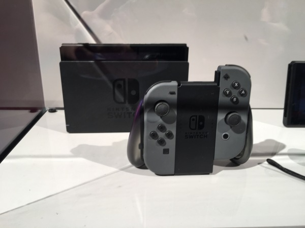nintendo_switch_console_behind_glass