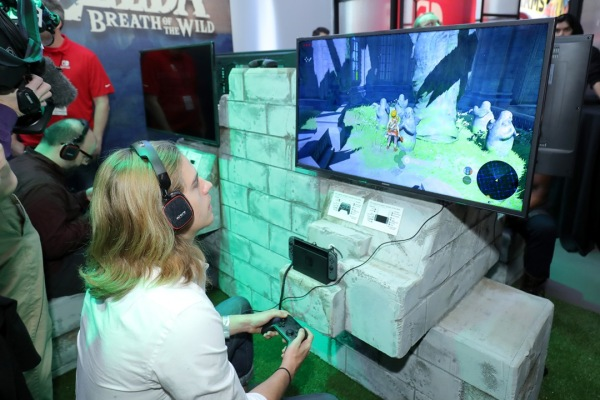 NEW YORK, NY - JANUARY 13:  In this photo provided by Nintendo of America, A guest enjoys playing The Legend of Zelda: Breath of the Wild on the groundbreaking new Nintendo Switch at a special preview event in New York on Jan. 13, 2017. Launching in March 3, 2017,  Nintendo Switch combines the power of a home console with the mobility of a handheld. It's a new era in gaming that delivers entirely new ways to play wherever and whenever people want. (Photo by Neilson Barnard/Getty Images for Nintendo of America)